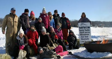 Kids and organizers pose for a photo in the early hours of the 12th annual Constance Bay Kids Ice Fishing Derby. Photo by Jake Davies
