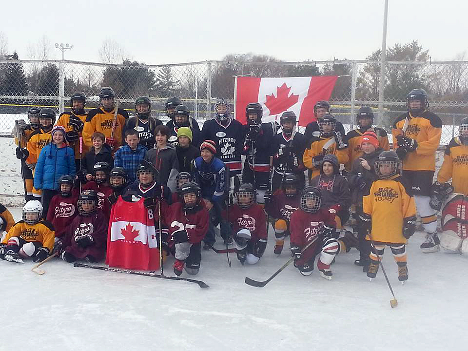 The Fitzroy Harbour Winter Carnival kicks off tonight. This photo is from a previous carnival and shows the WCOHL Fitzroy Harbour teams celebrating Hockey Day in Canada. Photo courtesy FHCA