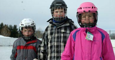 From left, Ryan, 6, John,10, and Mackenzie, 9, Stanton enjoy a beautiful skate on the Corkery outdoor rink last season. Photo by Jake Davies