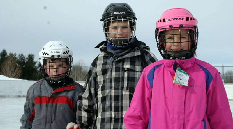 From left, Ryan, 6, John,10, and Mackenzie, 9, Stanton enjoy a beautiful skate on the Corkery outdoor rink last season. Photo by Jake Davies