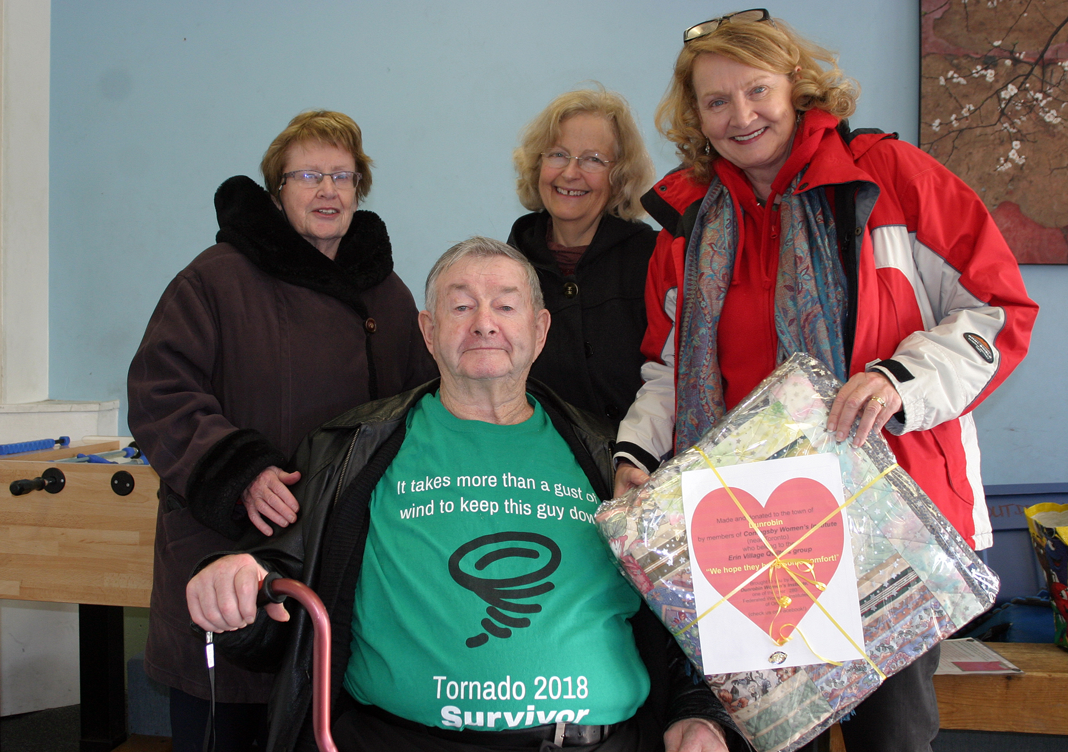 From left, Adele and Leo Muldoon, Dunrobin WI President Beth McEwen and MP Karen McCrimmon. Photo by Jake Davies