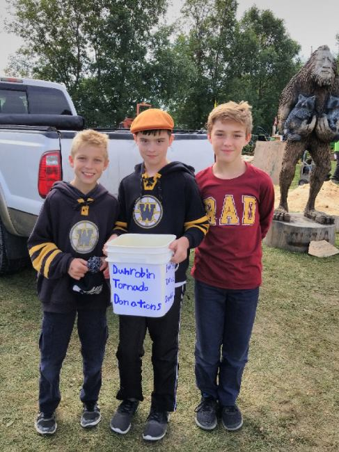 Members of the Warriors were at the Carp Fair the day after the tornado fundraising for relief. They raised more than $4,100. Photo courtesy The Warriors
