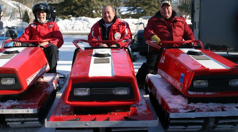 From left, Randy Heinle, Roy Taske and Bruce Schoblaska pose on their Red Diablos at the 13th annual Constance Bay Old Sled Run. Photo by Jake Davies