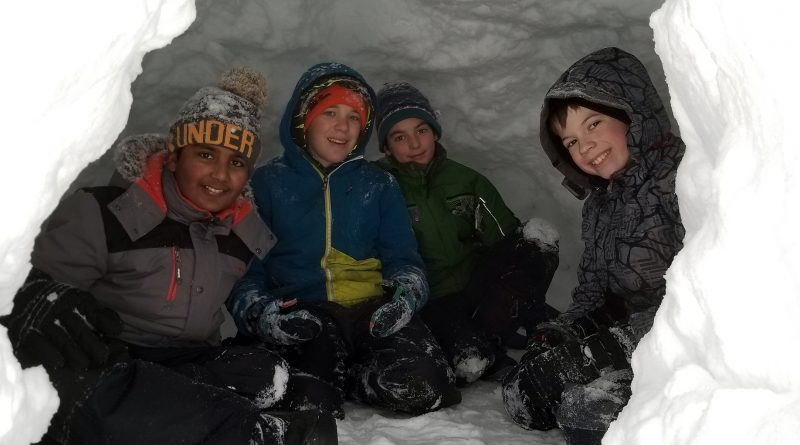 Members of the 116th Nepean Scout Troop snug as winter bugs in their quinzhees. Photo submitted