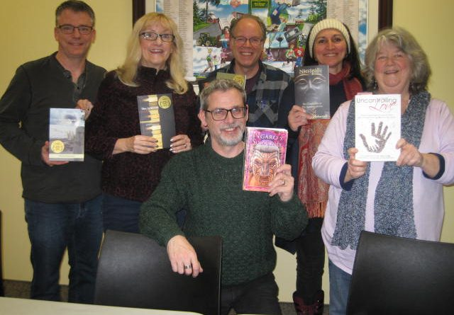 Author Michel Weatherall,in front, poses with members of the Carp Creative Writers' Group Wednesday evening. Photo courtesy Carp Branch OPL