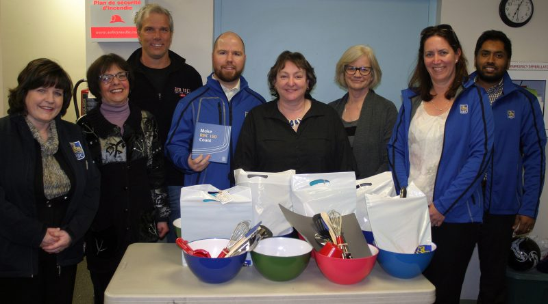 The Dunrobin Community Association and staff of the Royal Bank of Canada pose with the RBC's donation of kitchen supplies for the special needs cooking program. Photo by Jake Davies