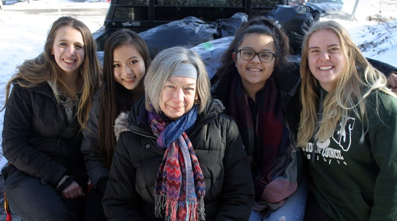 From left, WCSS students Michelle Gandelman, Sylvia Qi, Savvy Seconds' Vera Jones, Sam Sharp and Alicia Briggs pose with a truckload of donated clothes. Photo by Jake Davies