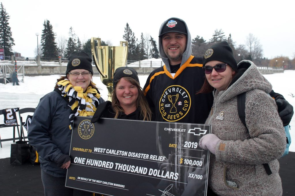 Lori McGrath, Shelley Welsh, Sean Lecuyer and Laurie Chauvin pose with a really big cheque. Photo by Jake Davies