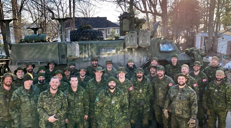 Members of 13 TP D Squadron of the Royal Canadian Dragoons pose for a photo after a day of work in Willola Beach. Photo by Britta Gerwin