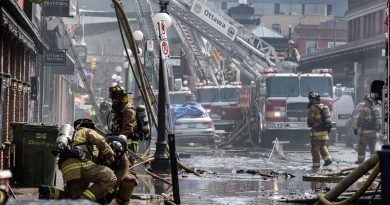 Firefighters battle Friday's Byward Market fire. Photo by Abigail Gossage