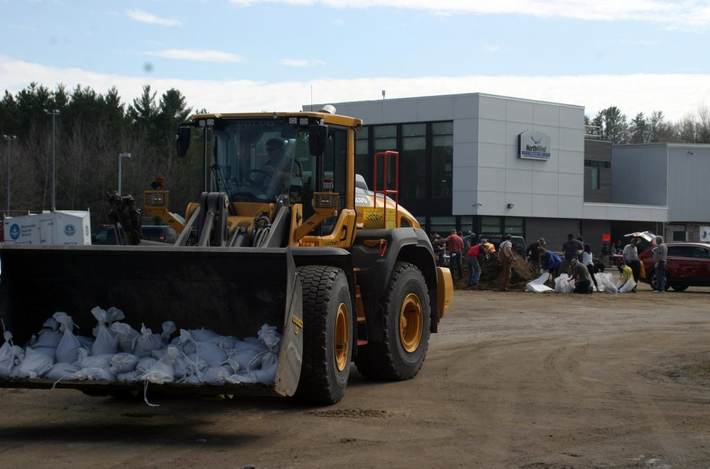 Official say more than 100 volunteers, many new, were hard at work in Constance Bay by noon today. Photo by Jake Davies