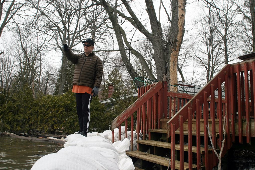 Homeowner Dave McKay, atop his wall of sandbags, hopes this year's levels of the Ottawa River during the spring freshet don't exceed 2017's levels. Photo by Jake Davies