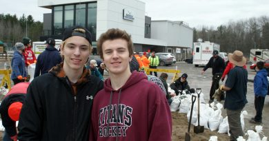 From left, WCSS students Jacob and Daniel Weedmark pitched in with about 30 other volunteers (around noon) to help fill sandbags at the Constance Bay communiy centre today. Photo by Jake Davies