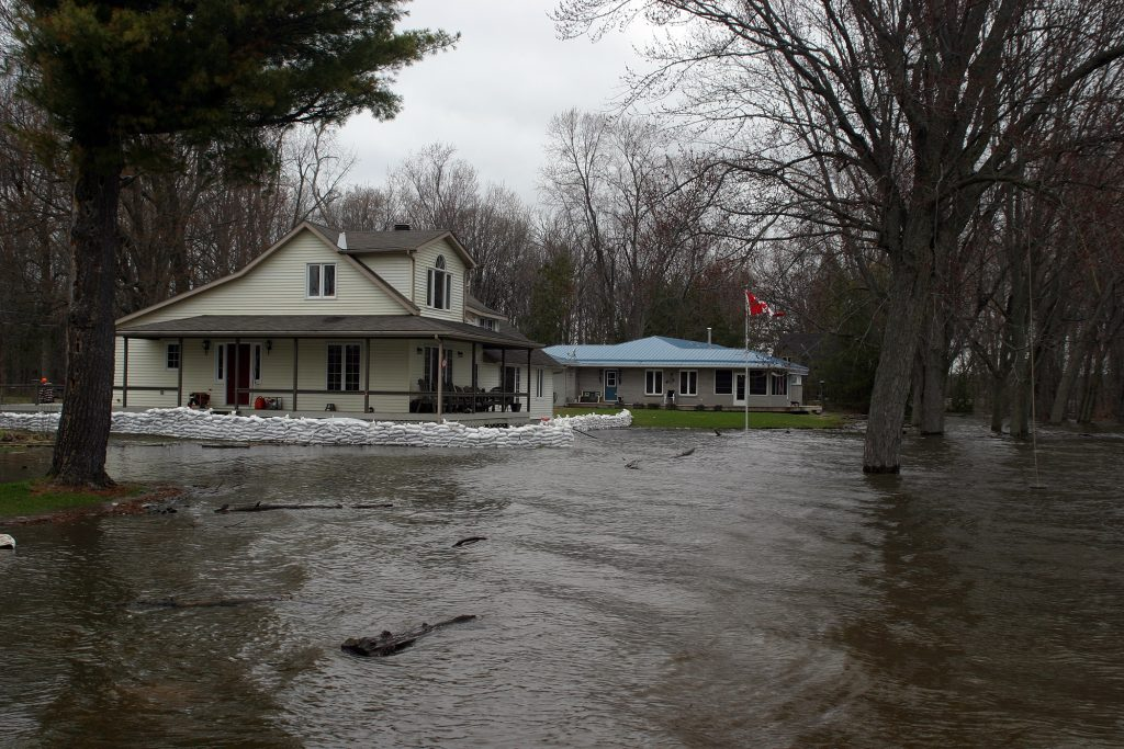 Former MPP Jack MacLaren's house in MacLaren's Landing has a small sandbag wall between it and the fast-rising Ottawa River. Photo by Jake Davies