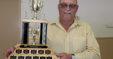 West Carleton Senior Council President Jim Wilson holds the West Carleton Seniors Oldest Participant Trophy awarded at the senior games. Photo by Jake Davies