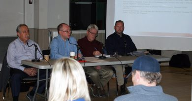 From left, Coun. Eli El-Chantiry, OC Transpo's Pat Scrimgeour, emcee Randal Denley and Bellville's Paul Buck. Photo by Jake Davies