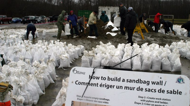Volunteers helped fill more than 2,000 sandbags today as West Carleton residents prepare for the worst but hope for the best. Photo by Jake Davies