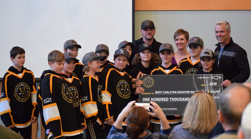 The West Carleton Warriors present a $100,000 cheque to WCDR co-chairs Greg Patacairk and Alex Lesnick. Photo by Shelley Welsh