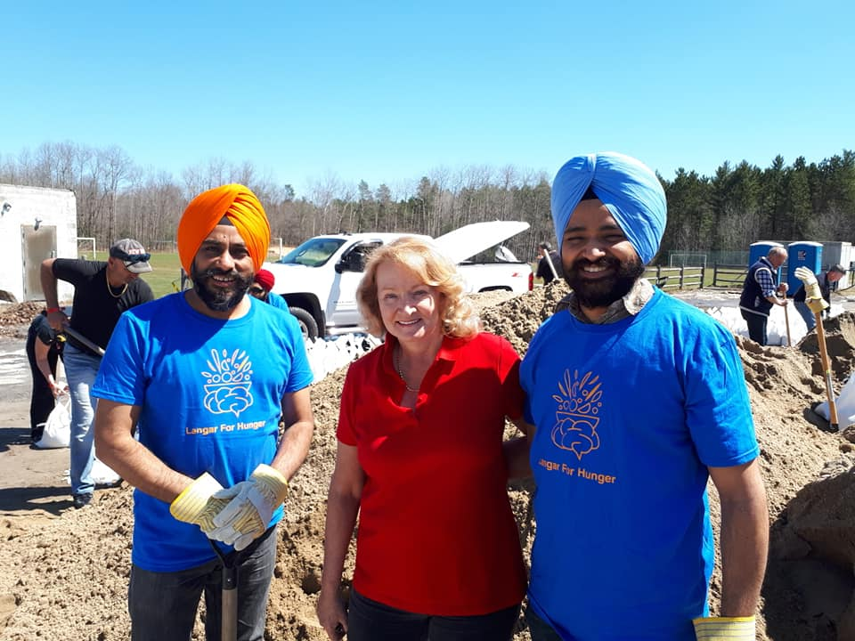 The Langar for Hunger team poses with MP Karen McCrimmon. Courtesy Langar for Hunger