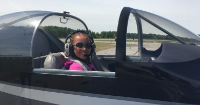 "Young Eagle Audrey Anderson doing her best ""Top Gun"" impression after flying with Matt Pearson in his Vans RV7A. Courtesy EAA"