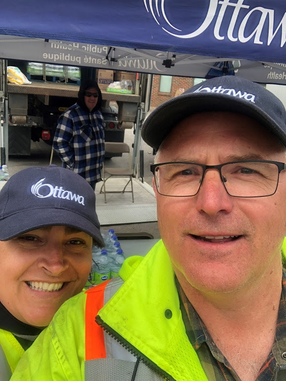 City staff Kimberlee Lambe and Shawn Norman felt welcomed by Constance Bay working at the commodities filling station. Courtesy City of Ottawa