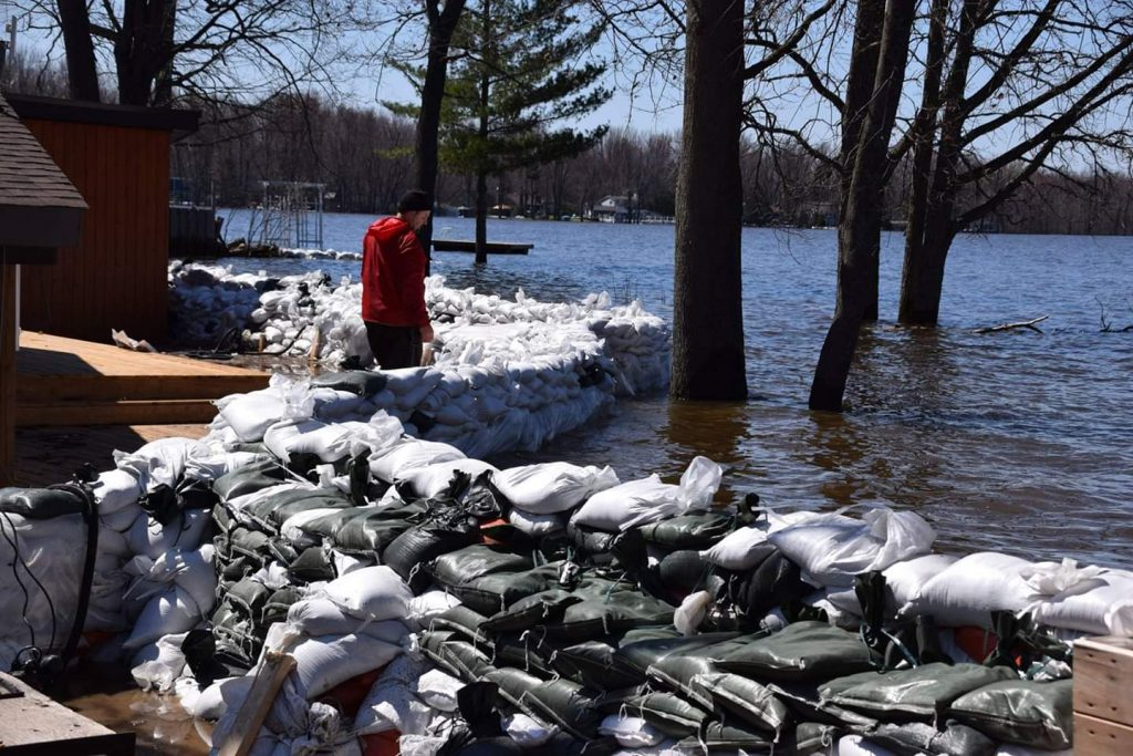 An Armitage Avenue resident checks his sandbag wall earlier this week. Photo by Shelley Welsh
