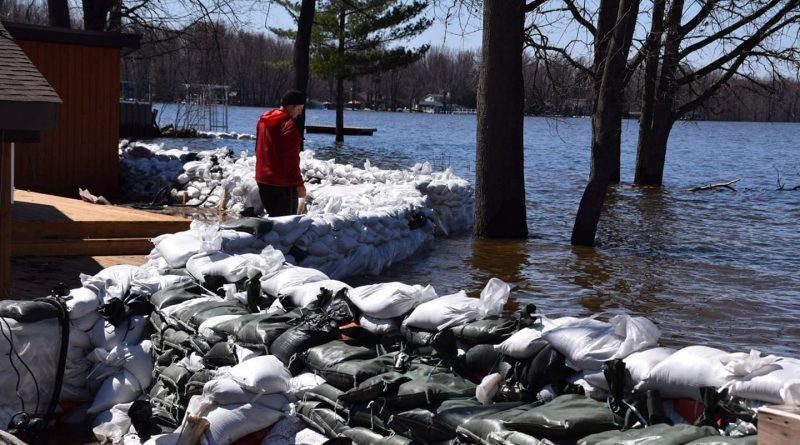Sandbag removal operations are set to hit high gear this weekend. Photo by Shelley Walsh