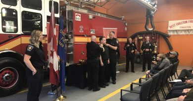 Firefighters Stephanie Clarke, far left, and Wade Wallace, receiving badge, were promoted to lieutenant on Wednesday. Courtesy Todd Horricks