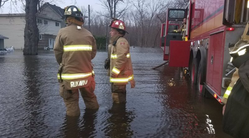 Constance Bay firefighters work in several feet of water battling the blaze that finished off Ryan Littler's home May 1, 2019. Courtesy OFS Chief Kim Ayotte