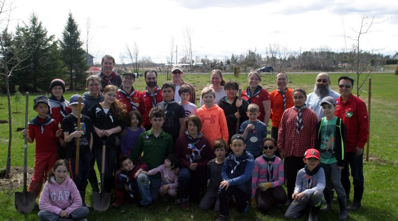 The Seventh Kanata Scouts, and a few volunteers and neighbours, pose for a photo after planting 300 trees in Dunrobin. Photo by Jake Davies