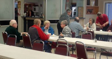 Some Constance Bay residents enjoy a community dinner at the West Carleton Royal Canadian Legion last Friday. It was the last meal the Legion will be providing to the flood-affected and volunteers after providing free food for more than a month. Photo by Jake Davies
