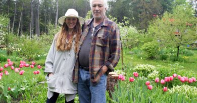 Megan Duffield and Jeffery Sugarman pose in their garden where their tulips (and others) are on full display in time for the 40th Red Trillium Studio Tour. Photo by Jake Davies