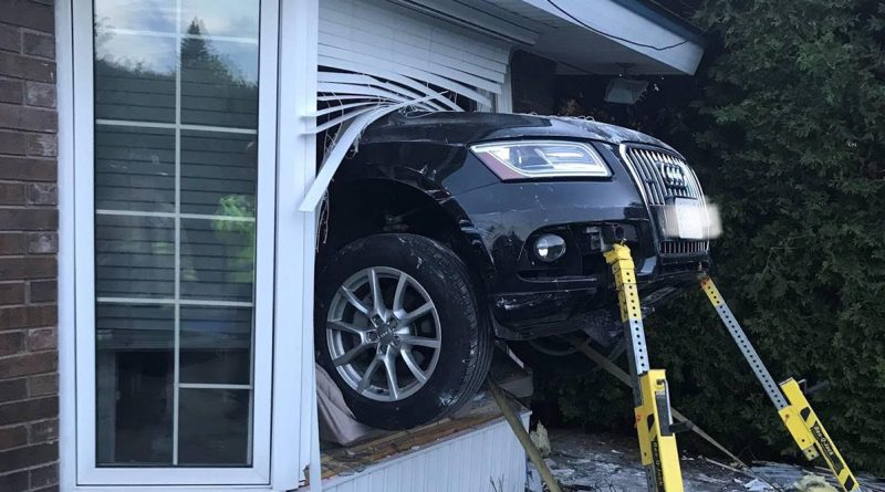 Firefighters had to secure this vehicle in order to extricate a victim in the home at the time of the collision. Courtesy OFS