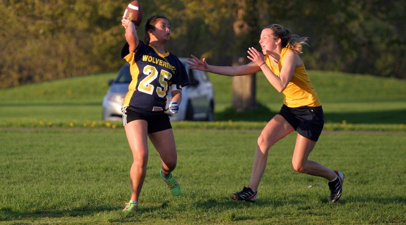 Wolverines quarterback Francesca Borrmeo completes a pass in the face of the pass rush in a game against the Bell Warriors Friday, May 24. Photo by Jake Davies