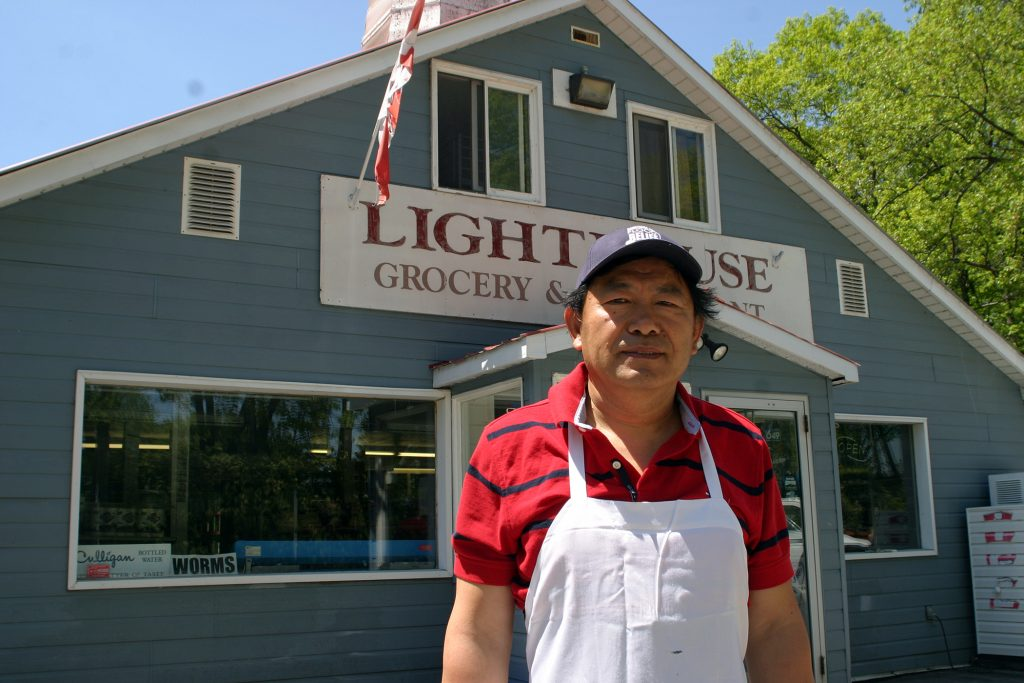 Lighthouse Restaurant owner Ji and his wife Sandy Zhang have dealt with two huge floods and now a pandemic in the last four years. Photo by Jake Davies