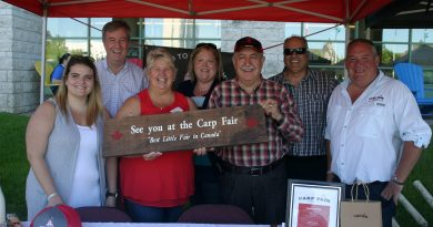 From left, the Carp Fair's Courteney Ross, Mayor Jim Watson, the fair's Lynn Hudson, past president Lisa Belton, Coun. Eli El-Chantiry, Coun. George Darouze, Carp Fair President Doug Norton. Photo by Jake Davies