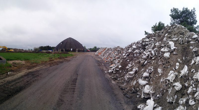 Used sandbags from this spring's flooding are being stored at a city facility near Woodlawn in this photo taken June 3. Photo by Jake Davies