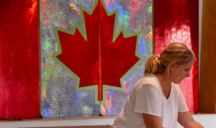 Artist Sarah Moffat works on her Canada Day piece that will be on display at Light Up Dunrobin on Canada Day. Photo by Shelley Welsh