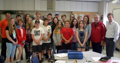 The St. Michael's School Fitzroy Harbour Grade 7 and 8 class pose with Coun. Eli El-Chantiry. Photo by Jake Davies