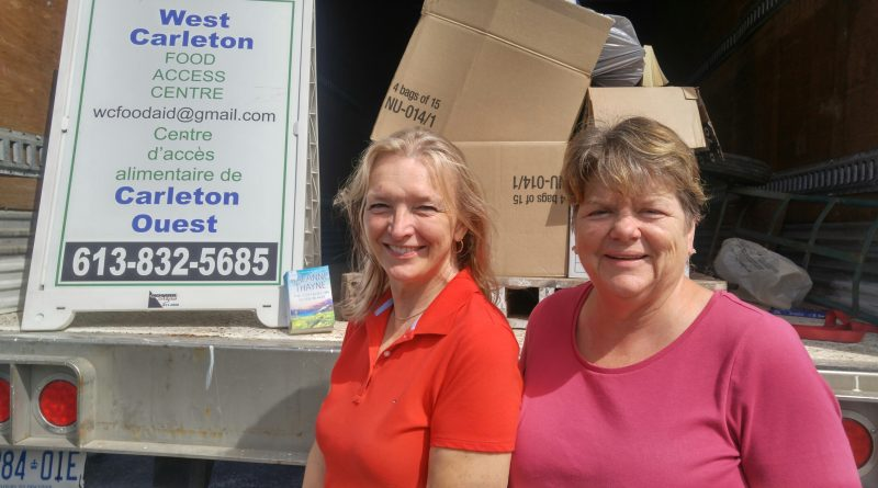 The West Carleton Food Access Centre's, from left, Karin Smith and Pamela Ross pose for a photo at last year's colossal book sale. Photo by Jake Davies