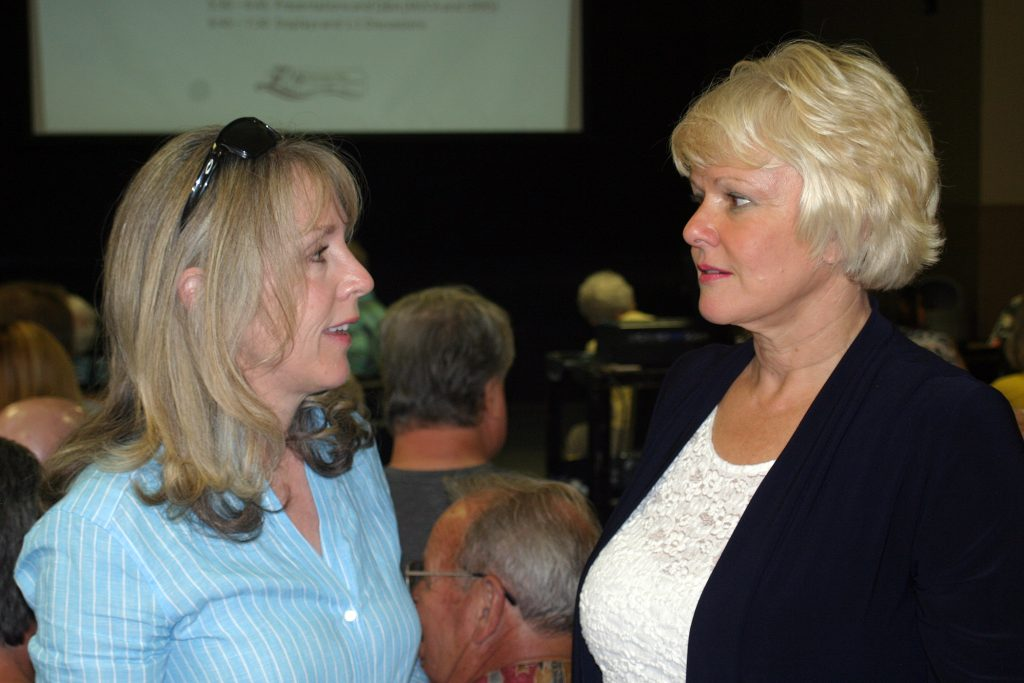 Kanata-Carleton MPP Dr. Merrilee Fullerton talks with Renfrew-Nipissing-Pembroke MP Cheryl Gallant before the presentations at last night's meeting. Photo by Jake Davies