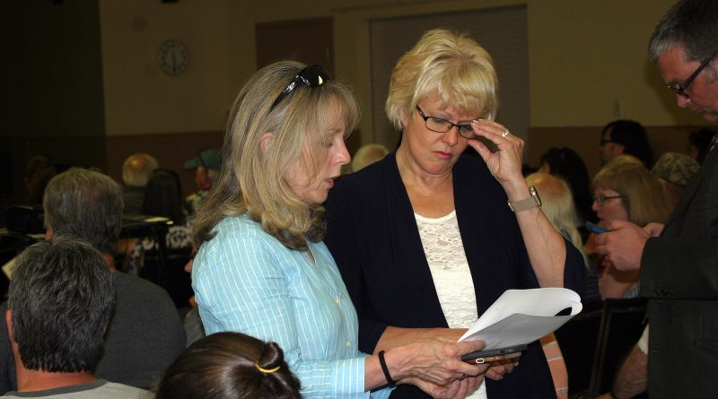 MP Cheryl Gallant, on the right with MPP Dr. Merrilee Fullerton at last Tuesday's flood meeting in Constance Bay, is requesting the federal government provide funding for those affected by the flood. Photo by Jake Davies