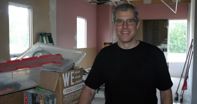 New Constance and Buckham's Bay Community Association President Kevin Pratt poses in the NorthWind Centre's newest addition, a commercial kitchen expected to be completed in the next couple weeks. Photo by Jake Davies