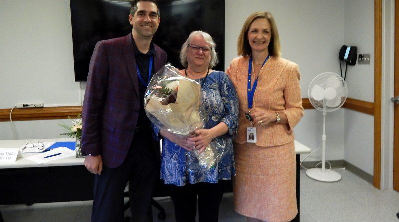 CPDMH board chair Rob Clayton and CEO Mary Wilson Trider congratulate Marg Leblanc. Courtesy CPDMH