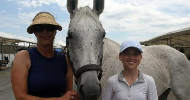 At right, Erin Wormald, 14, with her horse Goa and coach Sophia Nihon pose for a photo just prior to getting ready to compete Saturday afternoon. Photo by Jake Davies