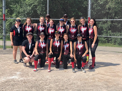 The u16 Stittsville 56ers: Top row, left to right: Carolyn Harman (coach), Jordyn LeBoutillier, Hailey Armstrong, Alison Roach, Sydney Watts, MacKenzie Bresee, Delaney Johnston, Kate Parks. Bottom row, left to right: Erin Durant (coach), Mikaylee Driver, Avery Smith, Paige Galbraith, and Brianna Flowers. Hiding in the back: coaches Brad Pender and Dale Aiken. Missing: Emmy Lecour, Jayde Shouldice and Lee Watts (manager/taker of this picture).