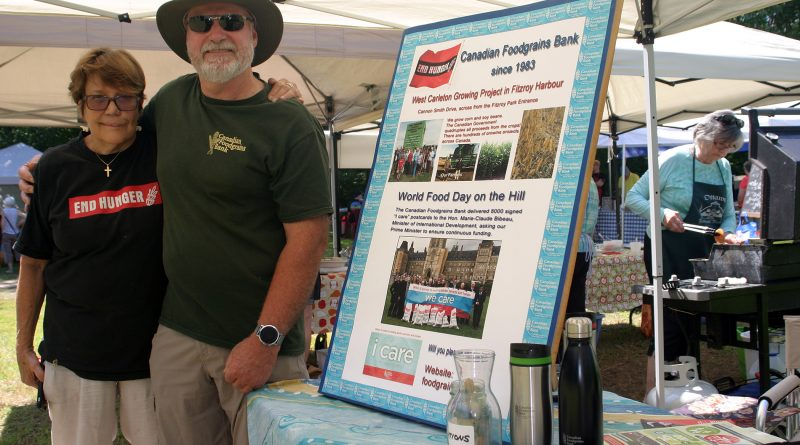 From left, Lisa Probst and Gary Weir spread the word of the West Carleton Foodgrains Bank Growing Project at the Saturday, July 13 Constance Bay Community Market. Photo by Jake Davies.