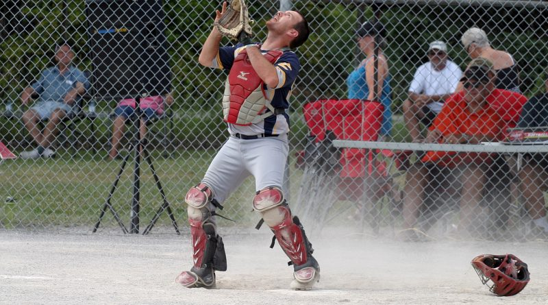 Electric catcher Chris Costello fields a pop fly in a game against the Elkland Beverage Co. during the 2019 Gil Read Memorial Fastball Tournament. Photo by Jake Davies