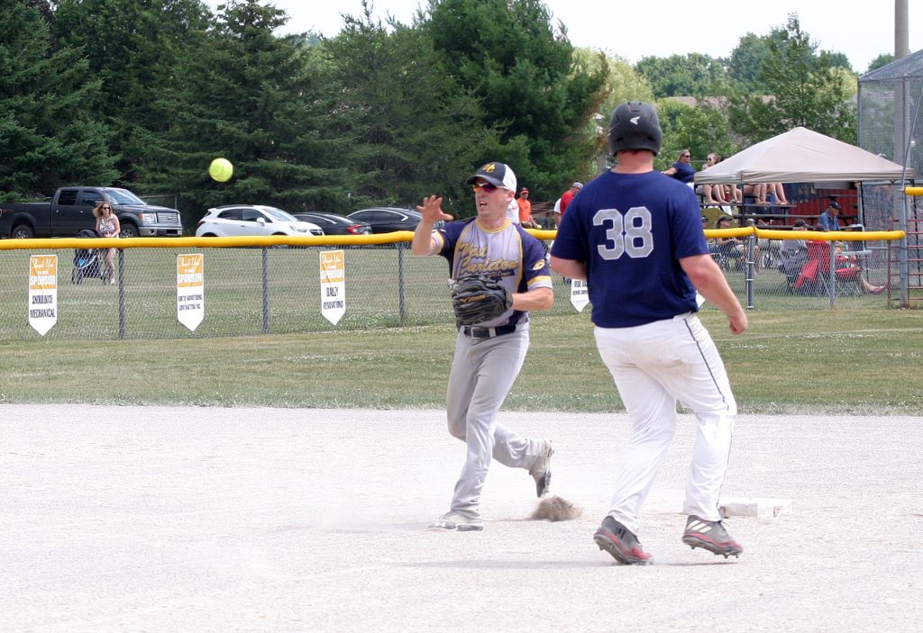 Kinburn's Scott Barton turns the double-play during a game against Elkland. Photo by Jake Davies