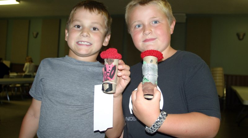 From left, Camden Moore, 7, and Emmet Belton, 6, show off their cowboy toilet roll at the Carp Fair Free Kids Craft Night last Wednesday. Photo by Jake Davies